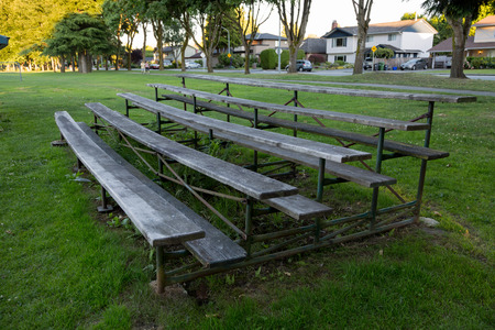 weed block: Seating Stands For Spectators In A Suburban Community Park