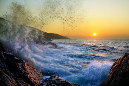 Lets stay a while longer, rough ocean at sunset,