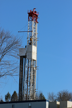 Yet another gas drilling rig goes up in Northeastern Pennsylvania. Фото со стока