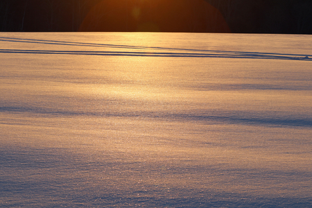 Sunrise on a field of ice covered snow.