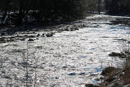 Loyalsock Creek rapids in the sun and shadows with boulders and ice. Stock fotó