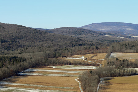 A well drilling pad is visible after drilling is complete in the hills of Pennsylvania.