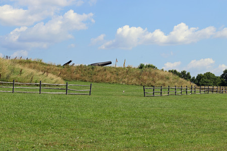 Cannons on the hill with a fence in a state park in Maryland.