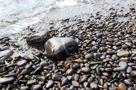 polished: Wave and polished rocks Stock Photo
