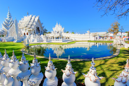 tourist attraction: Mirror lake inside public white temple with clear sky background