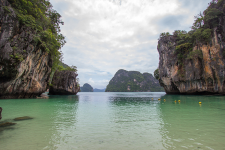 lading: Small bay surrounded by intricate limestone,soft white sand beach and emerald color sea at Lading island(Paradise island) in Krabi province,Southern Thailand.