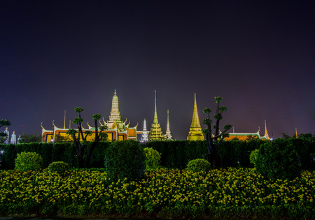 kaew: night scene of Grand Palace(Wat Phra Kaew) with Marigold flowers in the foreground,Bangkok,Thailand Editorial