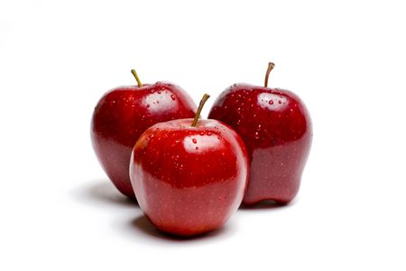 Red apples glistening with water isolated on white Imagens