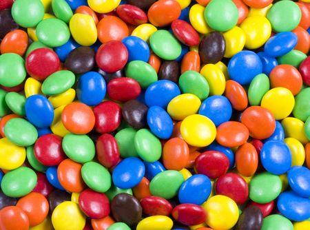 背景やパターンとして使用可能なカラフルなチョコレート菓子の詰め合わせ 写真素材