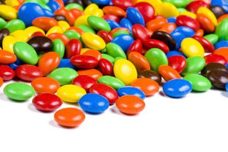 白地にカラフルなチョコレート菓子の詰め合わせ 写真素材