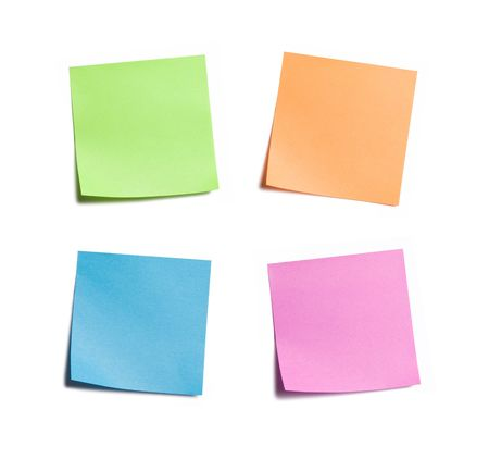 taped: Four vibrant sticky notes on white background