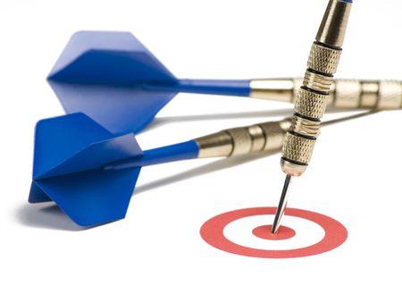 Blue dart hitting the target showing bull's eye