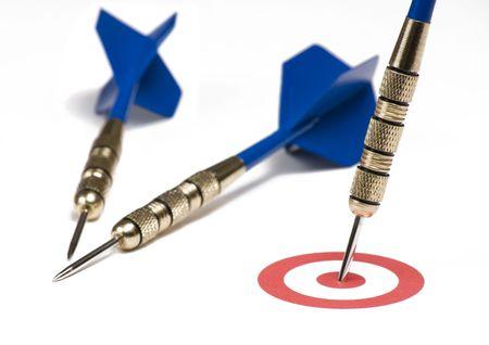 Blue dart hitting the target showing bulls eye
