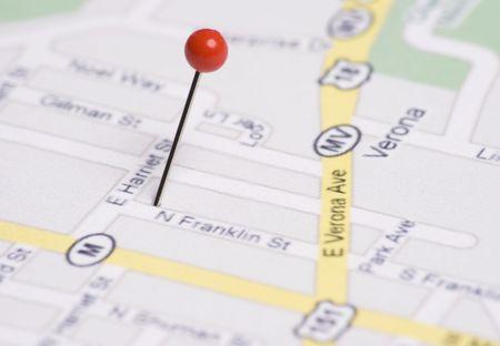 Red push pin stuck in map 版權商用圖片 - 3477591