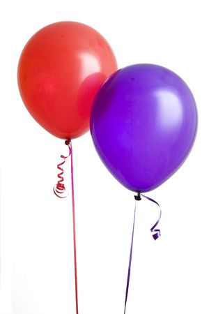 Red and purple balloons isolated on white background
