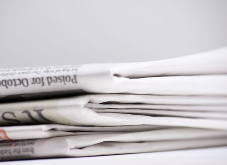 Newspapers on light background shot with very shallow depth of focus Imagens - 3539037