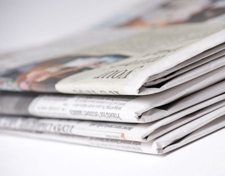 Newspapers on light background shot with very shallow depth of focus Imagens