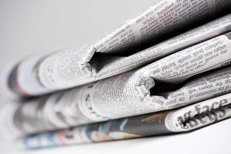 Newspapers on light background shot with very shallow depth of focus Stock Photo