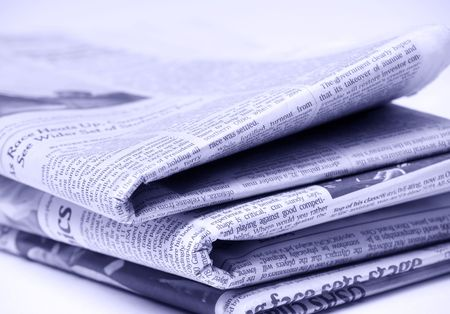 Blue tinted newspapers on light background shot with very shallow depth of focus Imagens - 3539051