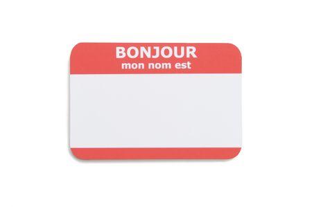 フランス語こんにちは白い背景で隔離の名札 写真素材