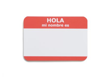 nombre: Spanish hello name tag isolated on white background