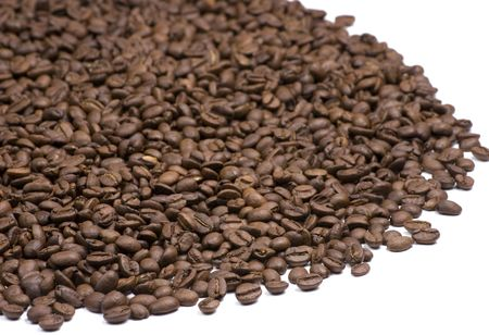 Large pile of coffee beans on a white background