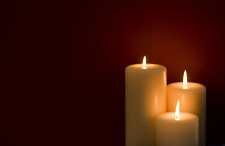Three candles on a red  写真素材