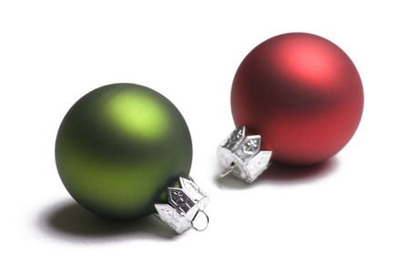 Green and red Christmas ornaments isolated on white  Imagens