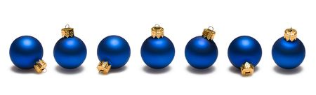 Blue christmas ornaments border on white background 写真素材