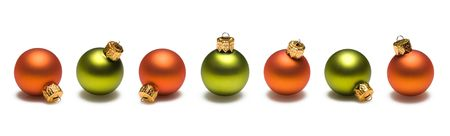 Green and orange christmas ornaments border on white background