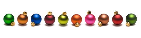 Christmas ornaments of many colors border on white background