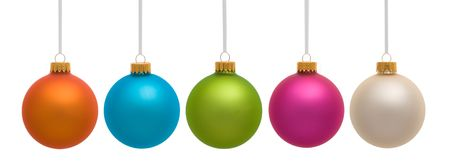 Five Christmas ornaments hanging on white background