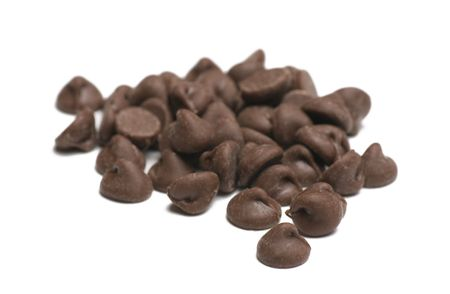 Chocolate chips on white background shallow depth of focus