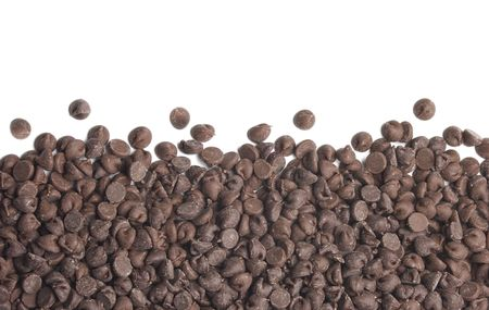 Chocolate chips border on a white background 写真素材