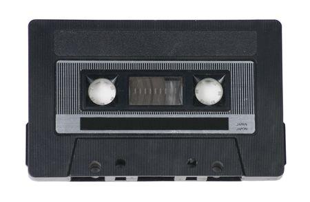 白い背景の上の古典的なレトロなオーディオ カセット テープ