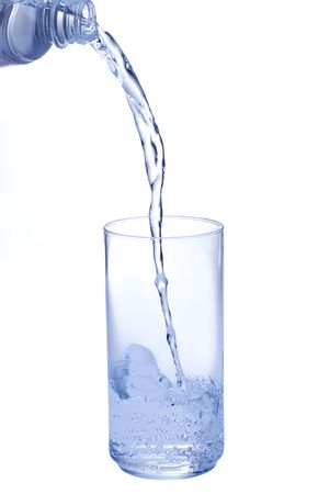 Pouring water into glass on white background Imagens