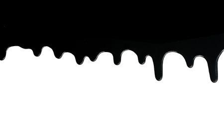 白い背景の上に滴下黒の塗料 写真素材