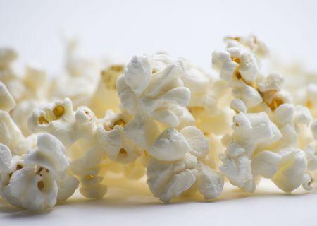 Popped popcorn on white