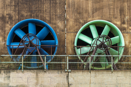ventilate: Large fans in an old industrial facade