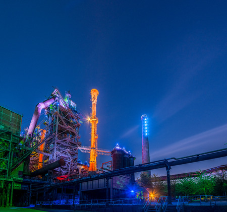 nightvision: Night portrait of an old factory with colored lights Stock Photo