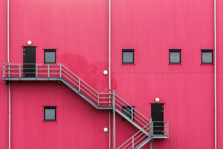emergency stair: Emergency staircase against a metal plated facade Stock Photo