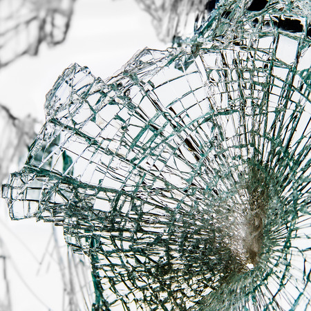 Smashed window pane as a result of vandalism