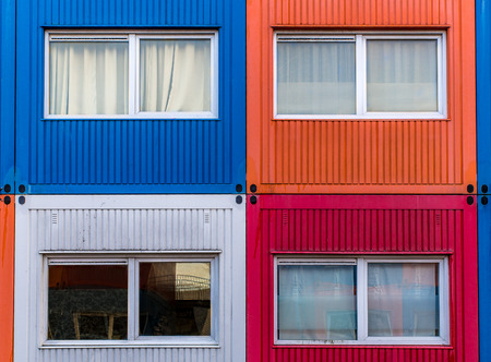 domestication: Container homes in white, red, orange and blue