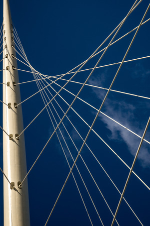 White cable stayed bridge showing beams and cables