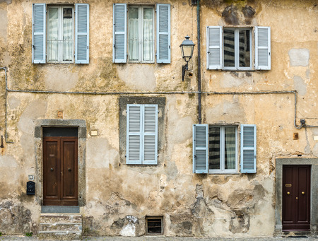 Old facade of houses in Tuscany, Italy
