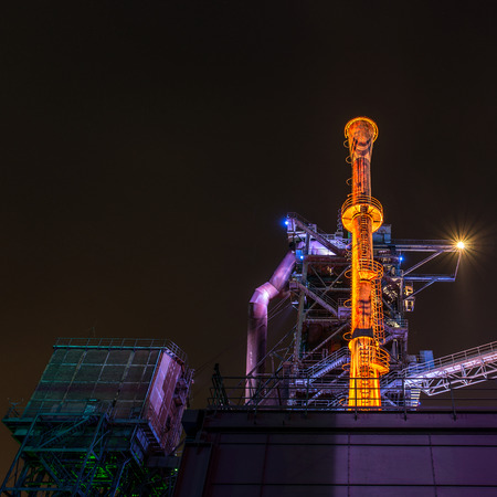 electrical equipment: Night portrait of an old and illuminated industrial plant