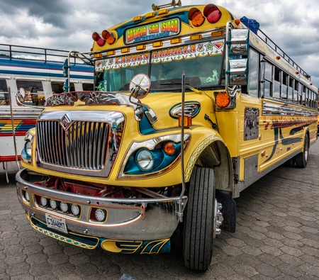 GUATEMALA CITY - AUGUST 1, 2018: Public transport in Guatemala is done with old american school buses painted in fresh colors.