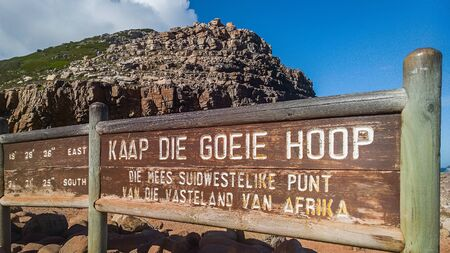 CAPE OF Many tourists photograph themselves at the sign of Cape of Good Hope. It is the most southern part of the peninsula