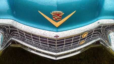BOSSCHENHOOFDNETHERLANDS-JUNE 11, 2018: a top and front view of a classic blue Cadillac at a classic car meeting