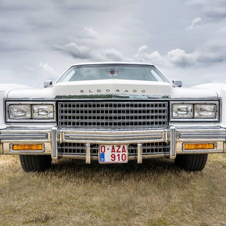 BOSSCHENHOOFDNETHERLANDS-JUNE 17, 2018: front view of a classic Cadillac El Dorado in white at a classic car meeting